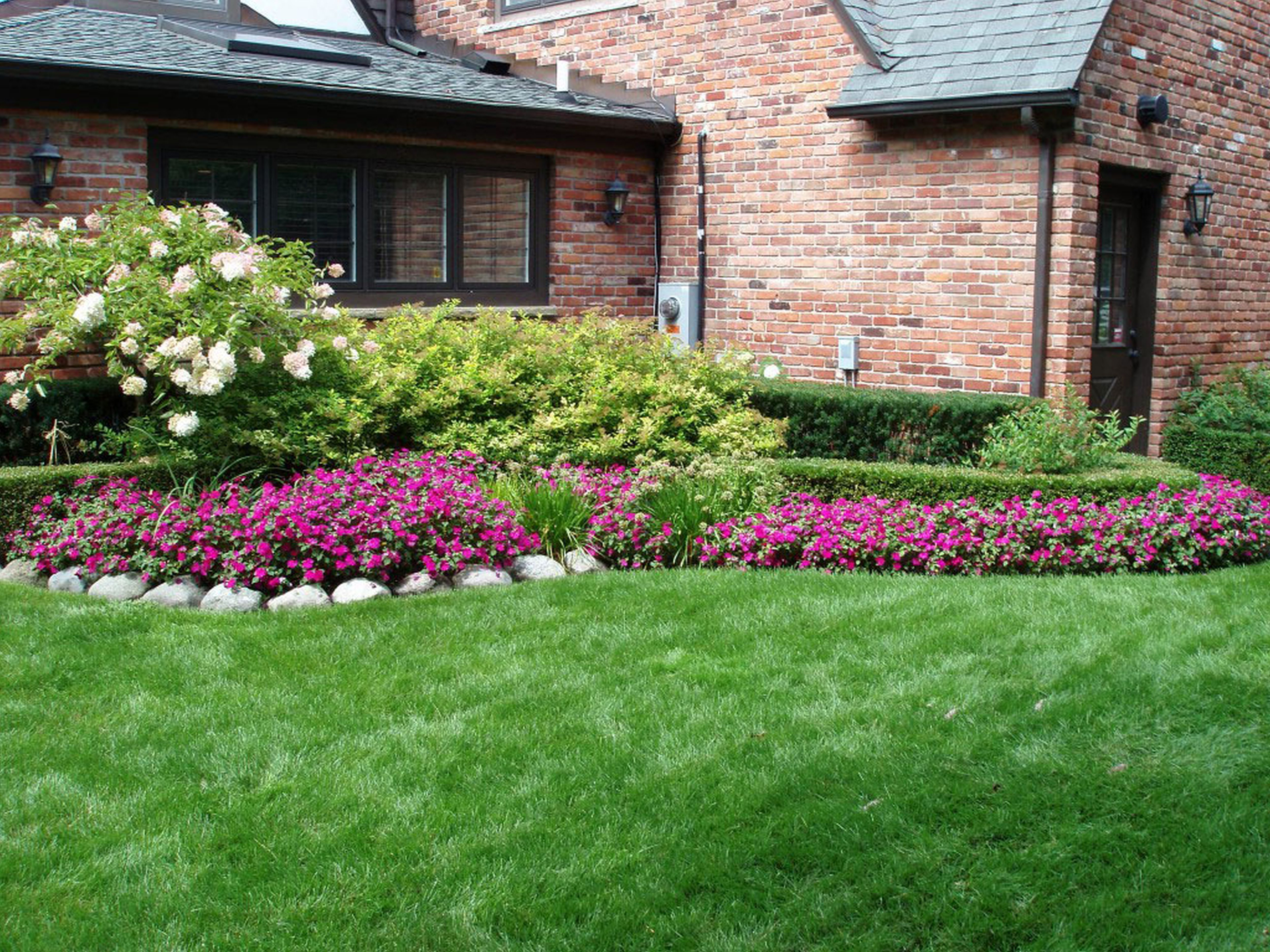 Low maintenance landscaping for vacation house backyard for Home landscaping ideas