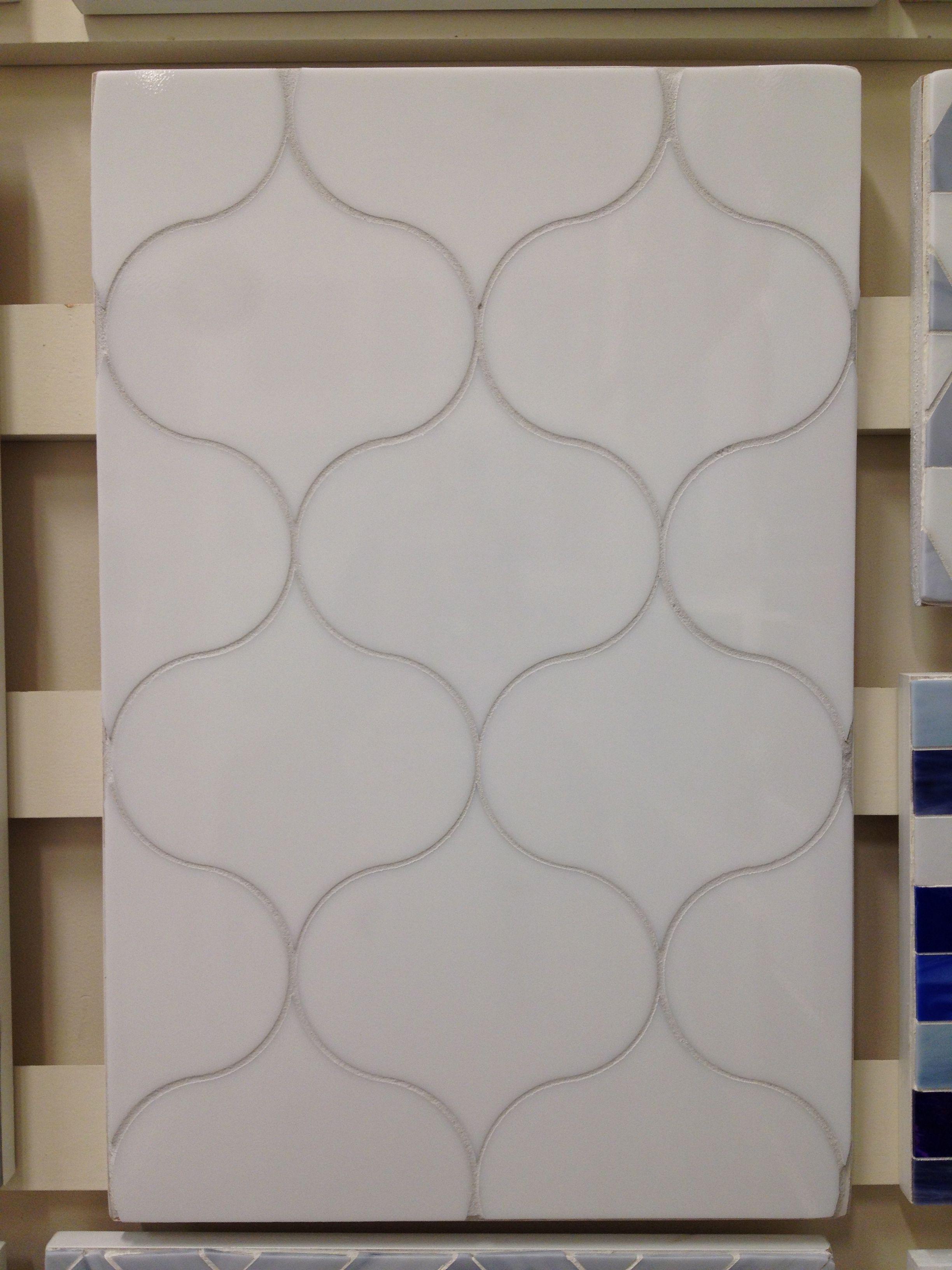 This crisp white ogee pattern backsplash tile looks easy to install