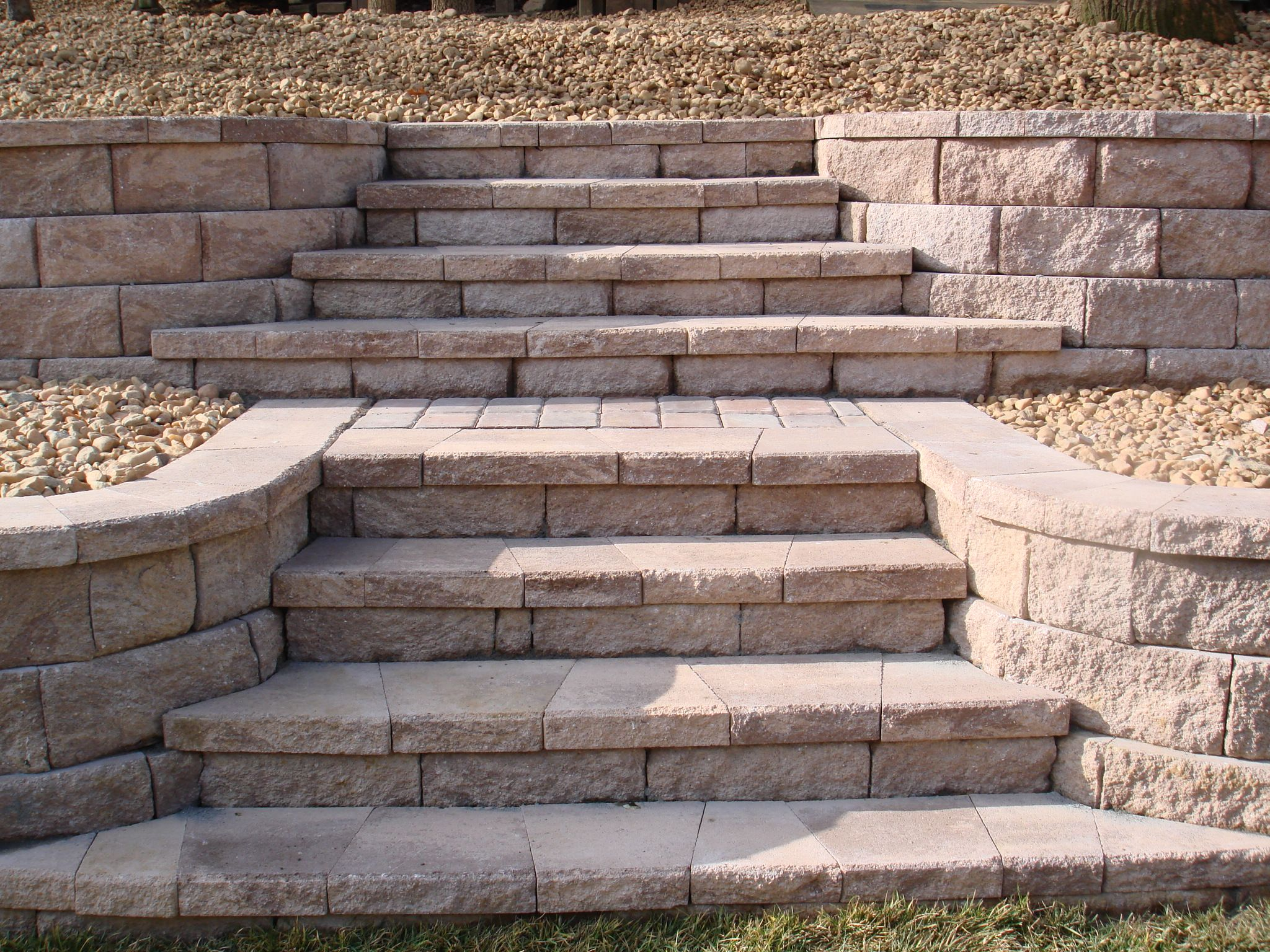 Retaining wall stairs retaining wall with stone steps for Exterior stone stairs design