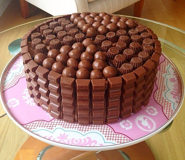 Chocolate fudge cake smothered in mini Reece's cups, maltesers and kinder Mai bars.
