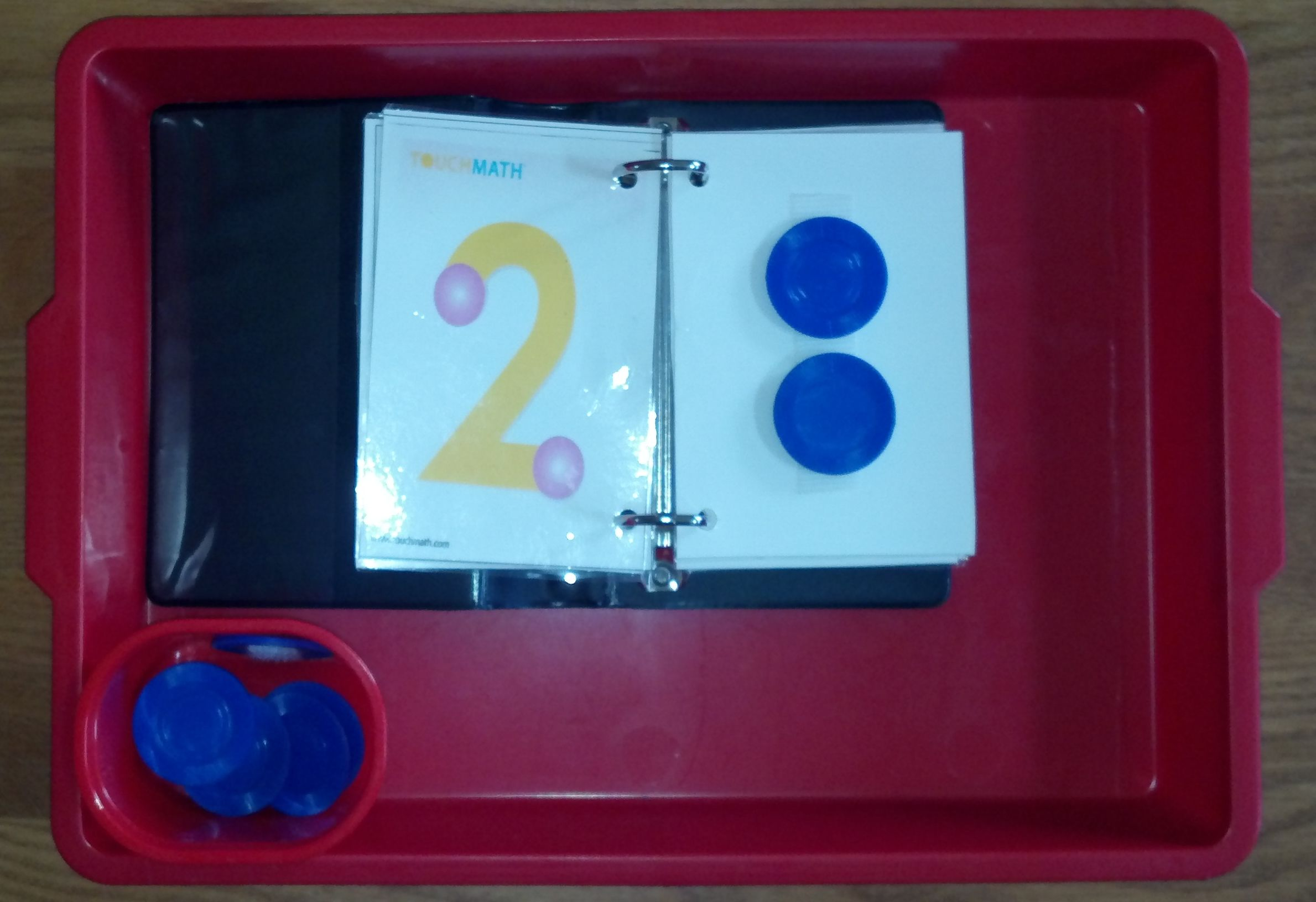 Touch Math: Child counts the dots on the number two and then puts on ...