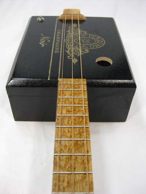 Perdoma Champagne Noir - 3 String Cigar Box Guitar with Louisiana Pecan Wood and Birdseye Maple.  The Grover tuners also make this a sharp lookin' CBG.