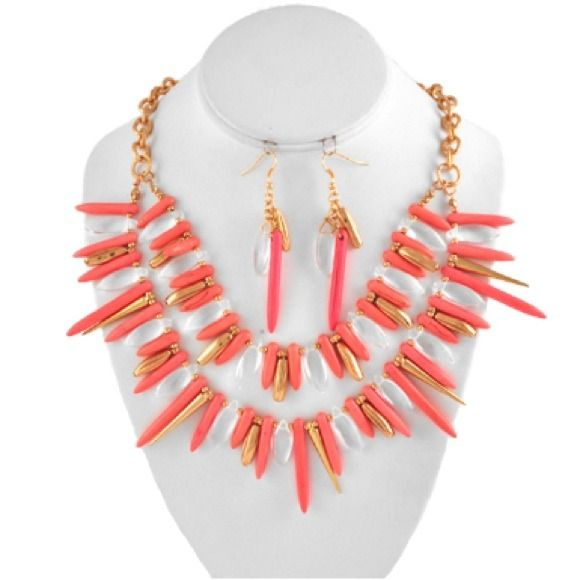 Coral Fringe Dual Layer Spike Necklace Set Coral Stones. Clear Beads & Gold Spikes. Antique Distressed Gold tone Chain and Hardware. Set Includes Matching Earrings. Fish Hook Wire Earring Back. Color: Coral. boujibroad.com Jewelry Necklaces