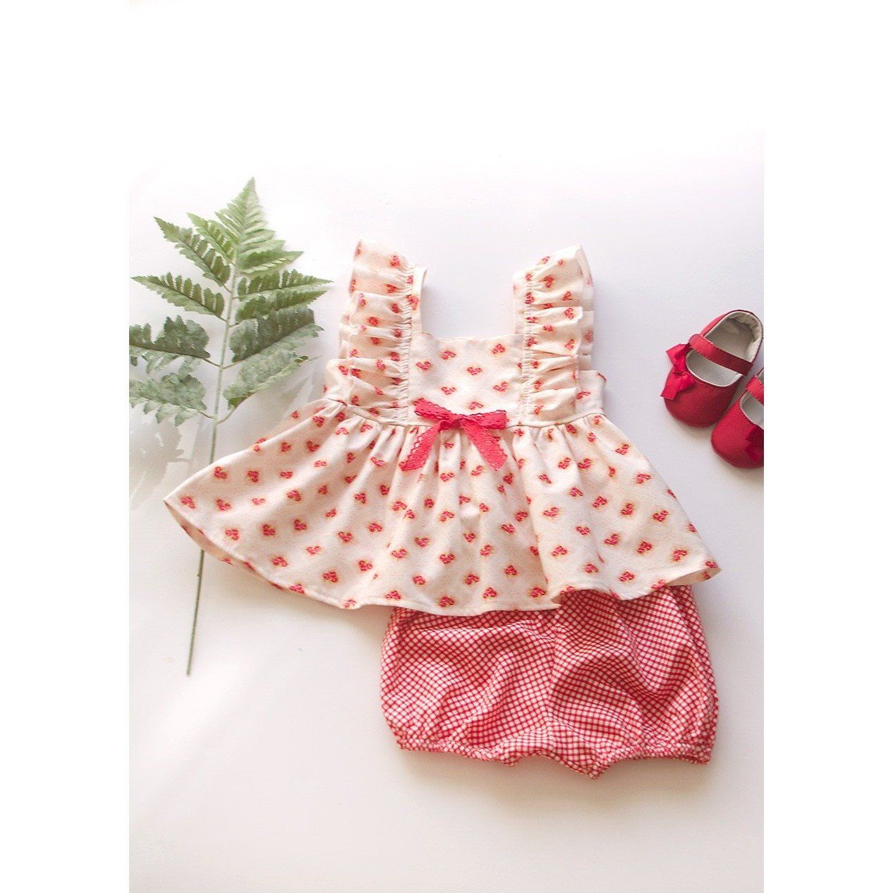 Welcome to summer fun with this two-piece baby girl shortie and flutter sleeve top.  Both pieces of handmade clothing are made out of 100% cotton fabric for a s