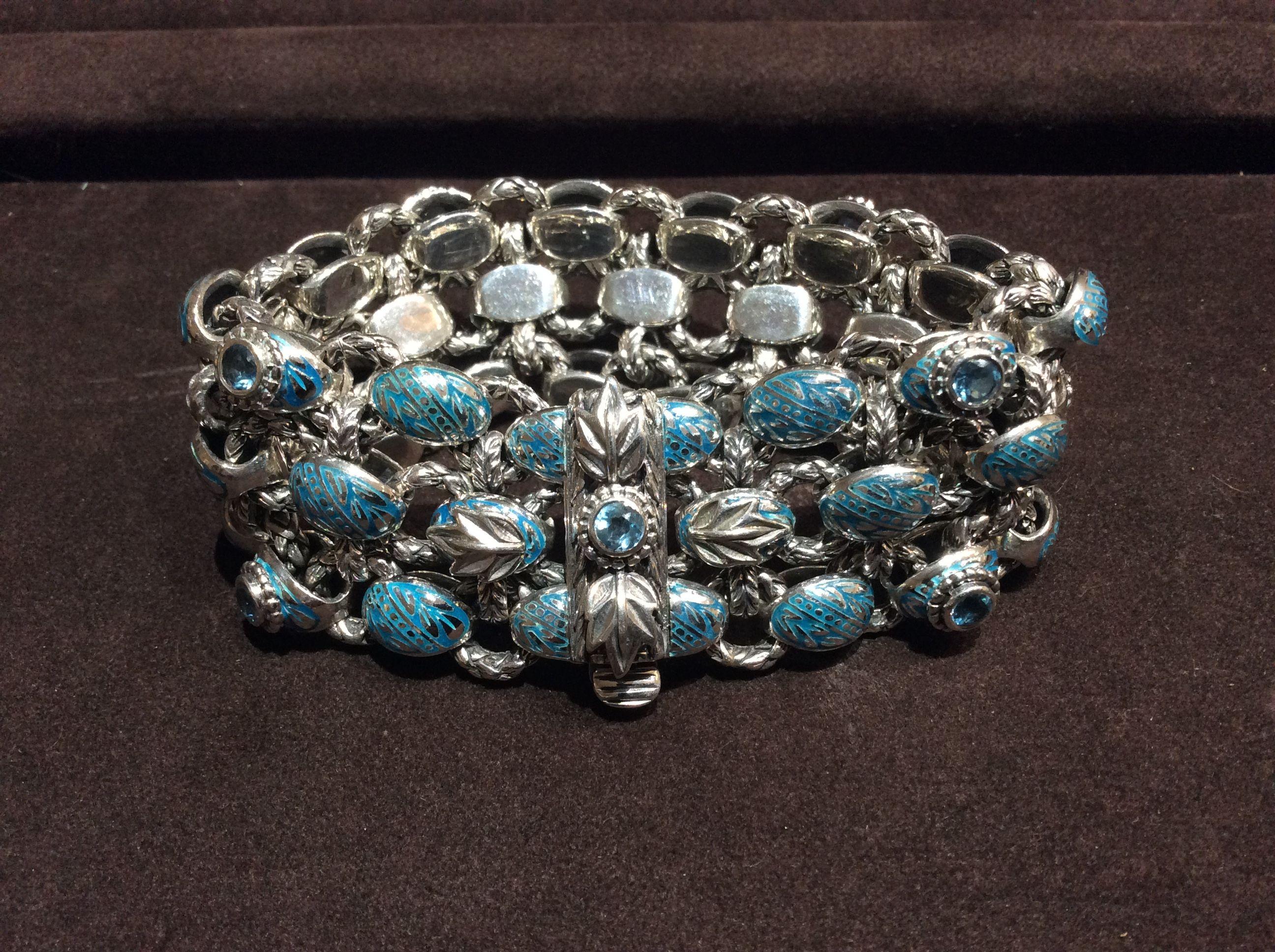 Handmade Sterling Silver, enamel, and Swiss Blue Topaz Laurel Leaf bracelet by Bowman Originals.