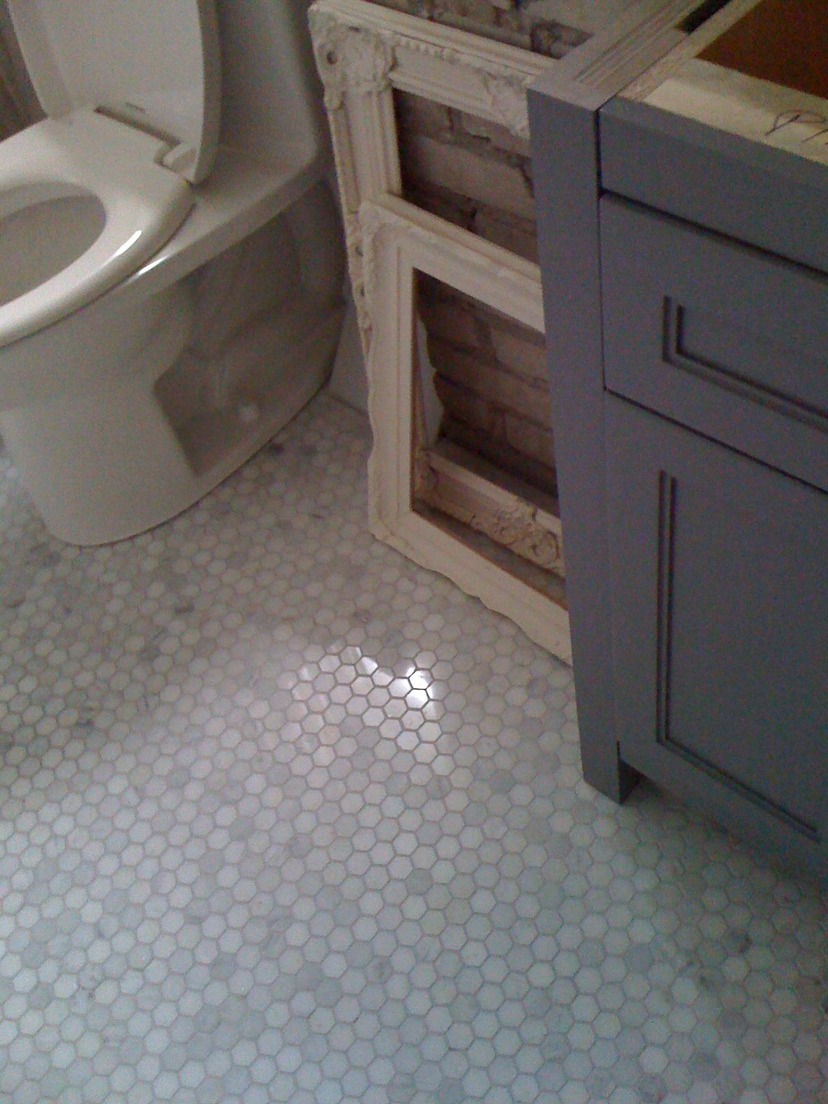 Colored Grout And New Tile Create Fresh Bathroom Look: Beautiful Installation Of Carrara Marble 1x1 Hex Tile