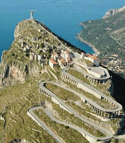 Maratea, Potenza, Basilicata, Italy - The statue of Christ the Redeemer, or the Christ of Maratea, was built of pure Carrara marble in 1965 by Bruno Innocenti, a sculptor from Florence. It is located on the top of Monte San Biagio.