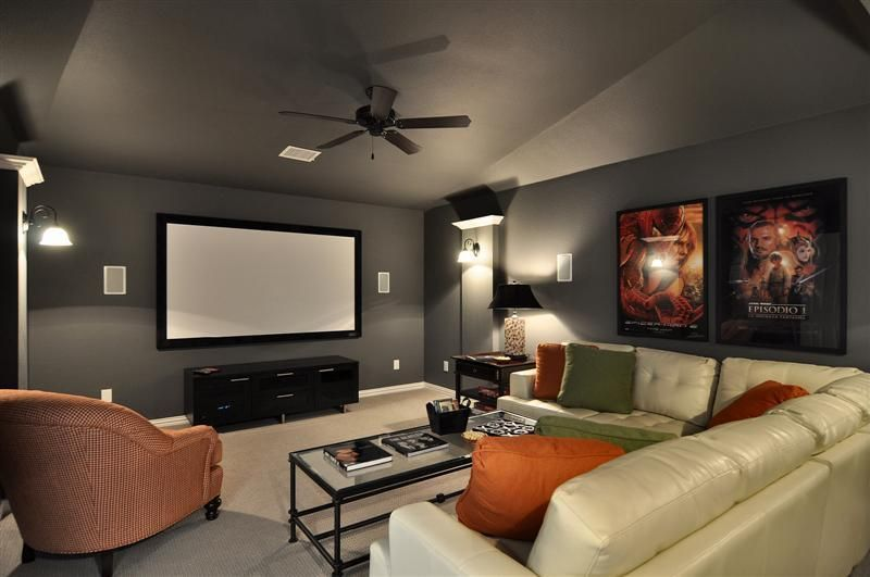 media room paint colorsI like the gray walls in this media room with the pop of orange