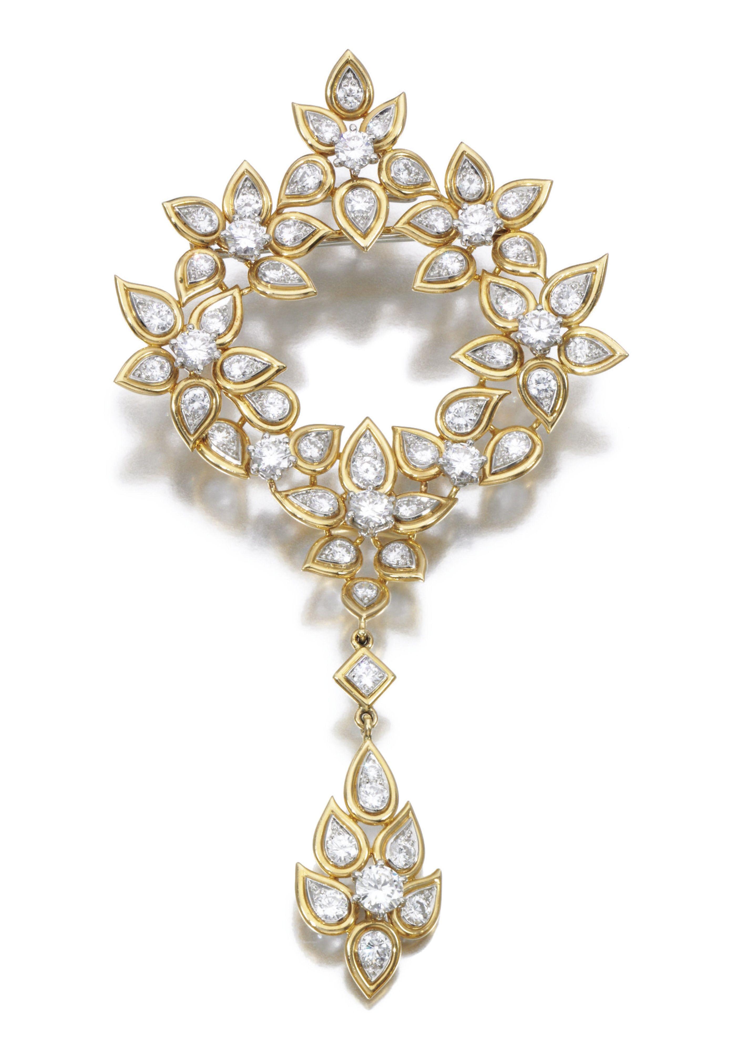 Diamond broochpendant cartier of foliate design set with