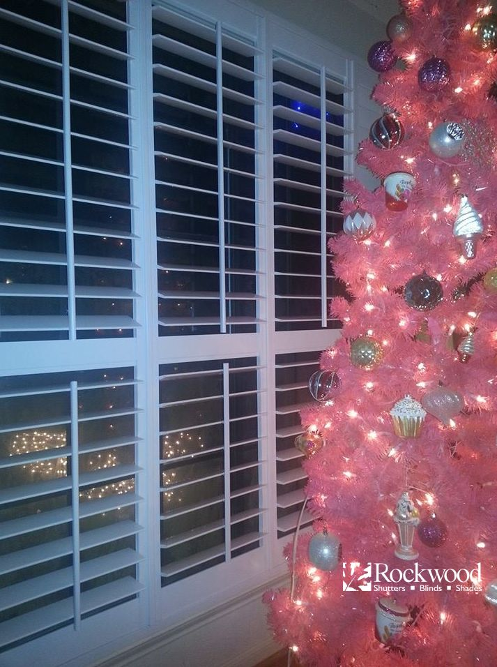 Newly Installed Shutters For Christmas With A Pink Christmas Tree