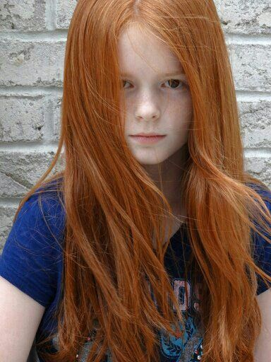 Young girl with red hair can