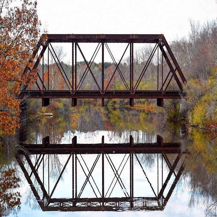 Reflection of the bridge on the Royal River in Yarmouth, Maine