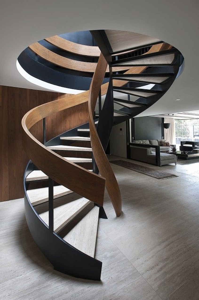This intriguing timber staircase set before a moody expanse of concrete has immense visual appeal.