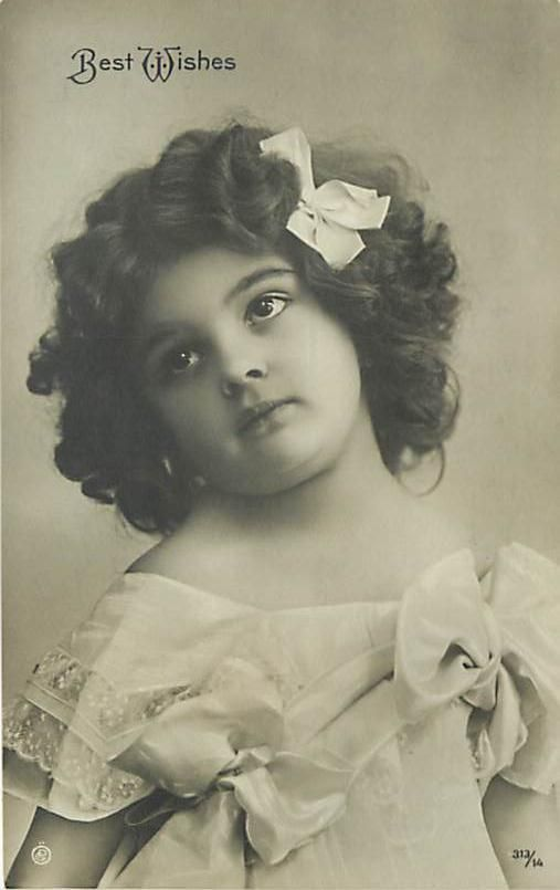 REAL PHOTO-BEST WISHES-LITTLE GIRL WITH BIG EYES-BOW-K33585