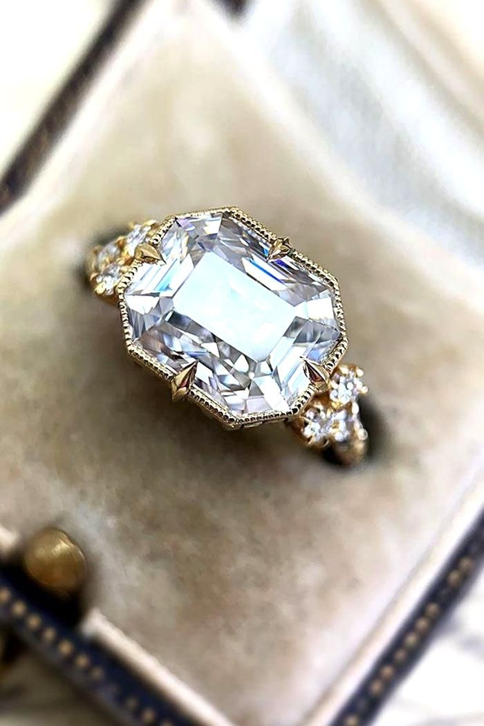 1.30 Carats Oval Cut with Pear Shape Side Stones D
