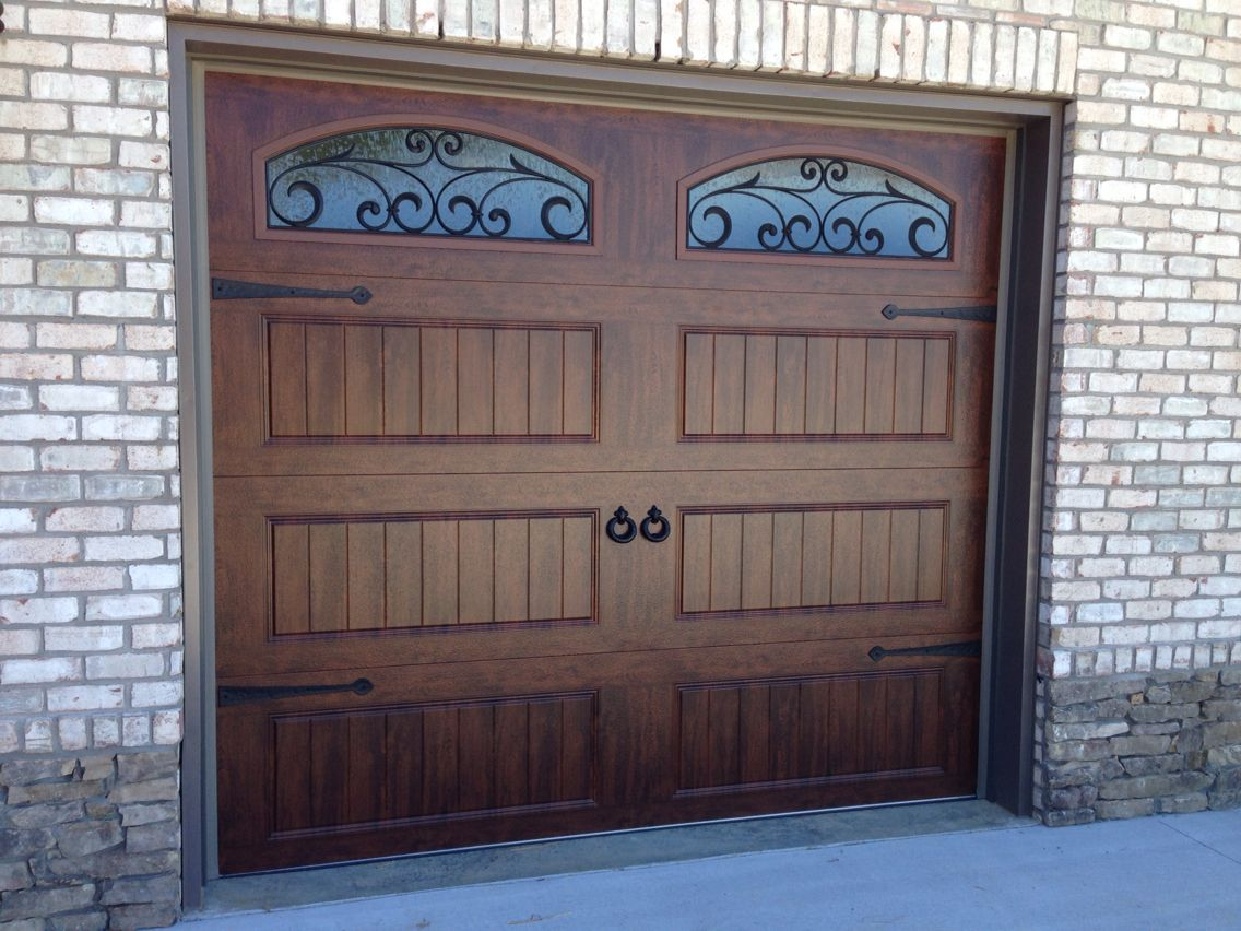 Garage door decorative accessories - Clopay Walnut Finish Gallery Collection Garage Doors With Arched Wrought Iron Windows And Decorative Hardware