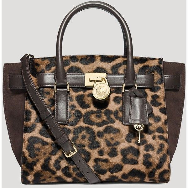 8260ffeb077f Leopard print calf hair and signature gold-tone hardware details give MICHAEL  Michael Kors