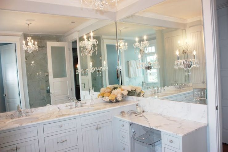 luxurious bathroom with white beadboard vanity cabinets and drop down make up vanity