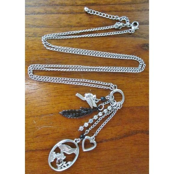 Cluster necklace silver chain, hangs medium length, charms include birds, faux diamonds, feathers Accessories
