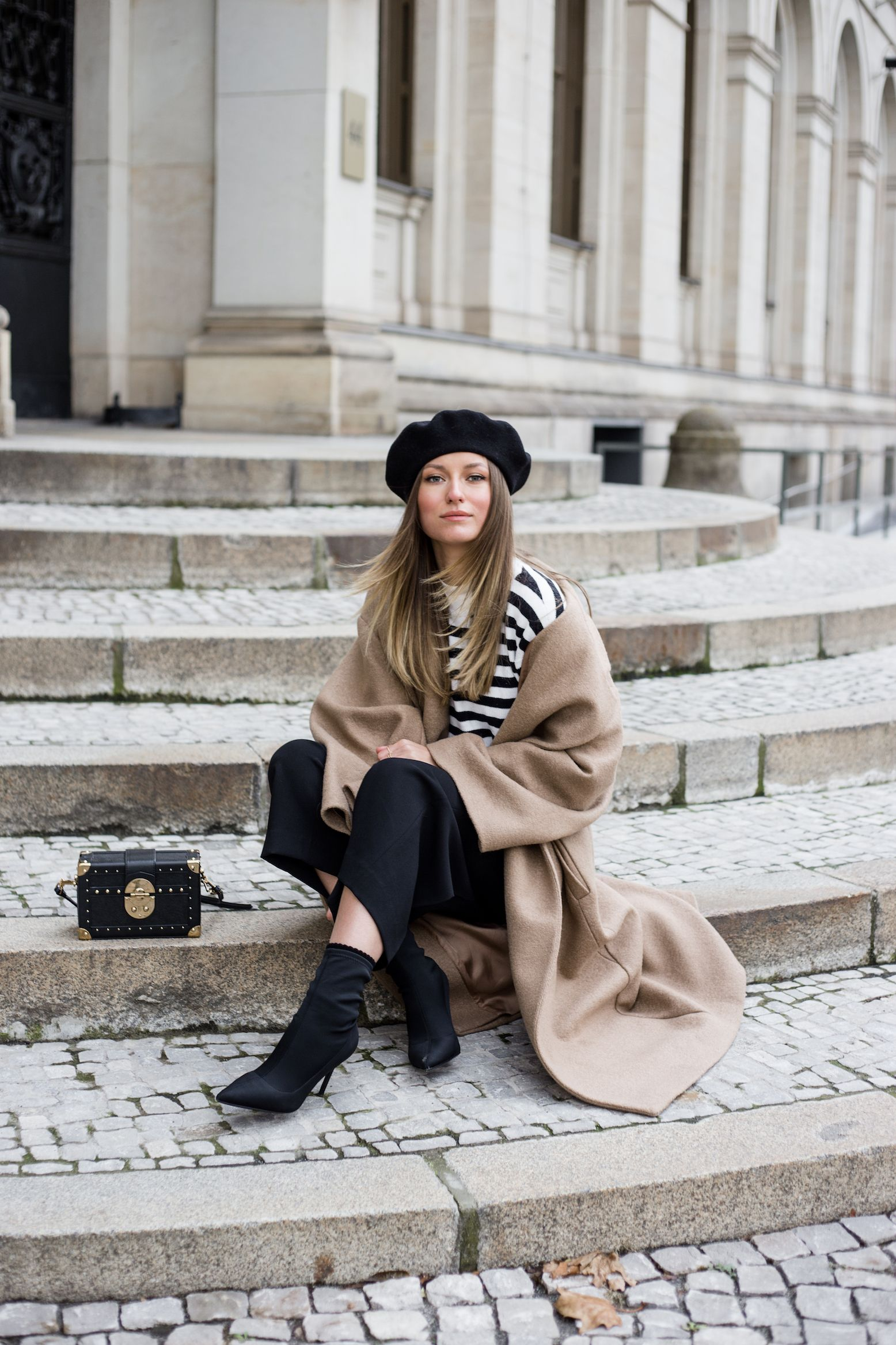 1d8a948f46e98 In this look I m wearing my H M oversized camel coat with my beret hat,  Mango coffer bag, a striped jumper from   other Stories and Mango sock  boots.