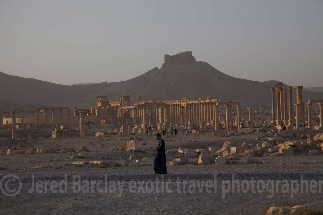 Man walking in a Syrian ruin at sunset. Seems this image could have been taken in the seventh century, no?