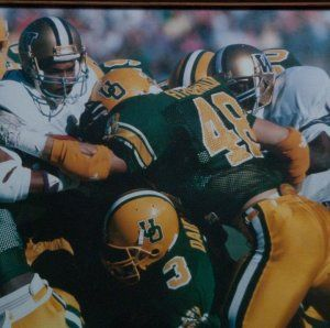 John Fitzgerald and Rory Dairy tackle a Husky 1989 ... Oldie but a goodie. Go ducks!!