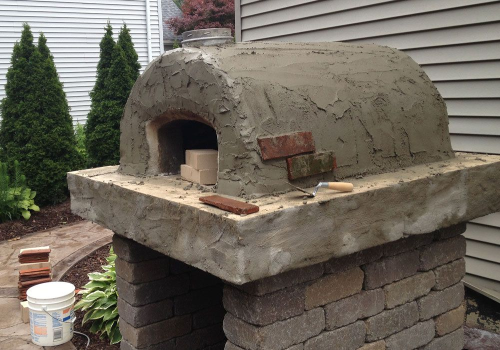 The Fisher Family Wood Fired Brick Pizza Oven in Ohio.  This awesome DIY Pizza Oven was built with the Cortile Barile oven forms by BrickWood Ovens.