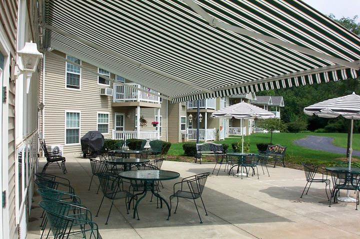 Large Patio No Problem We Have Large Span Retractable Awnings With All Kinds Of Options Retractable Awning Courtyard Landscaping Awning
