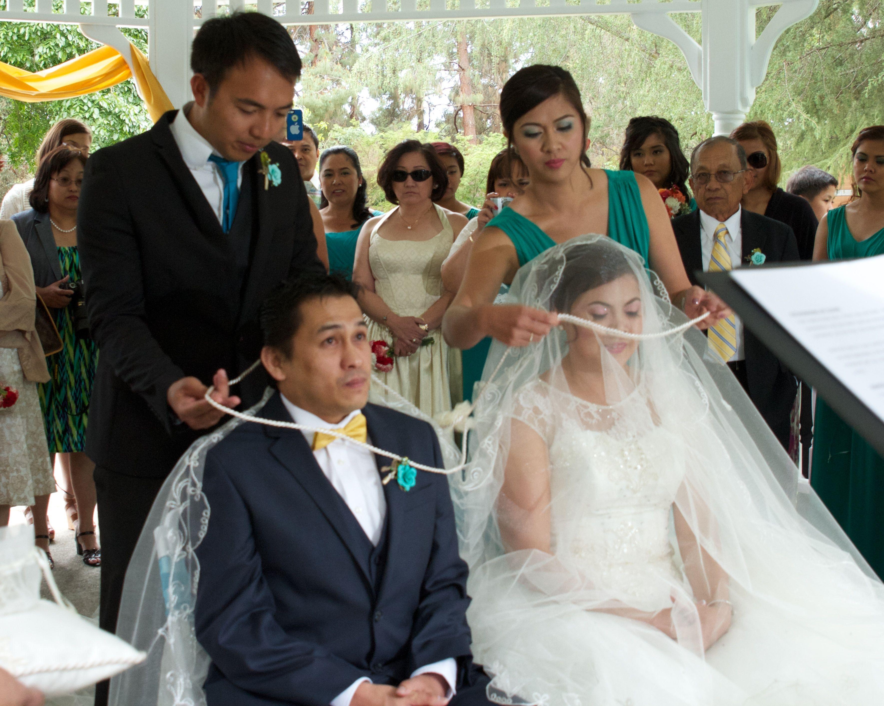traditional filipino veilcord and coins wedding ceremony by senior pastor tomas of calistoga