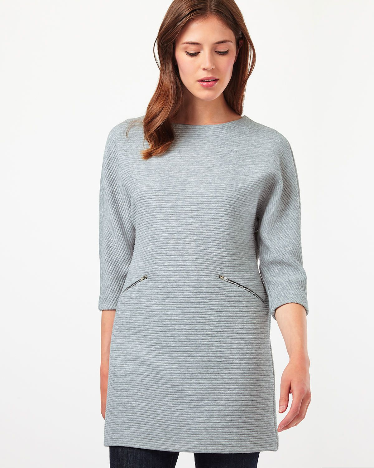 3b84f5c42a7554 An effortless tunic in a stylish Ottoman ribbed design. Complete with 3/4  length sleeves, a slash neck and zip details at the waist.