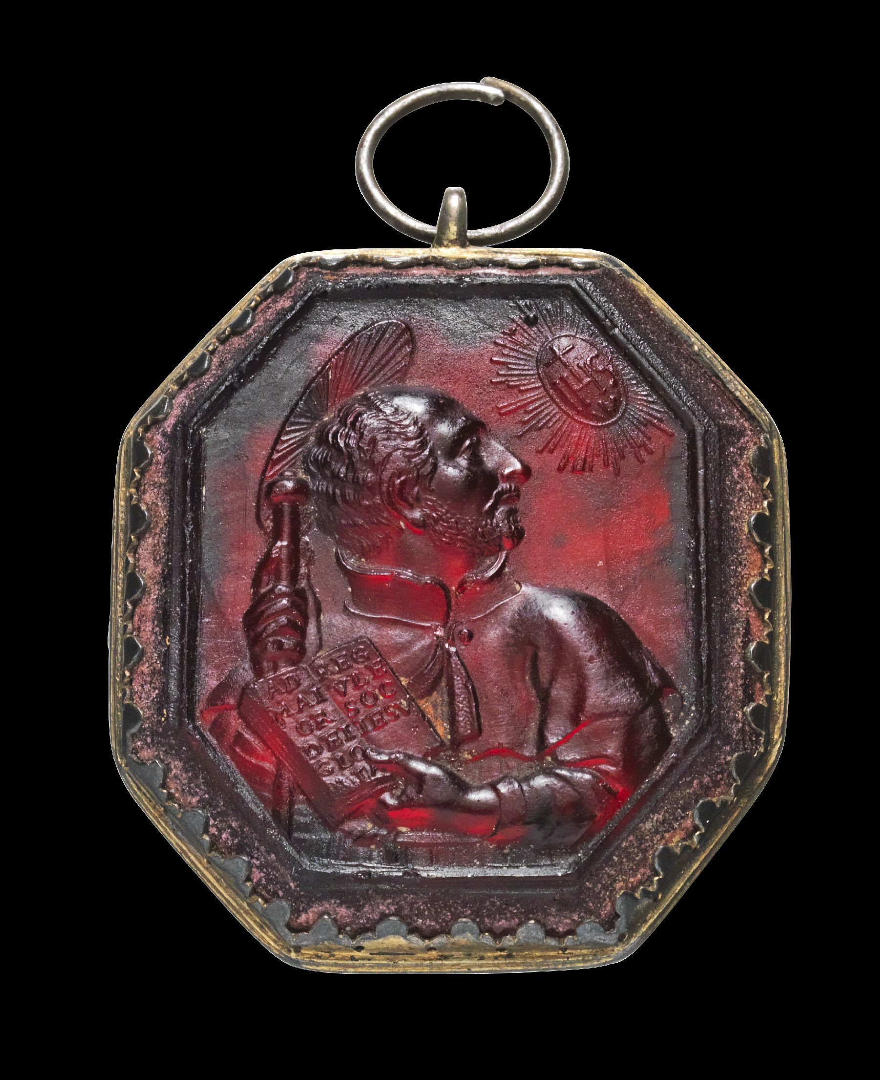 Octagonal cameo made of Bordeaux Red glass, mounted into a gilded silver medallion showing Ignatius of Loyola. End 16th - early 17th century.