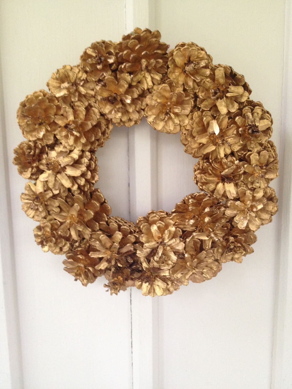 frugal do it yourself pine cone wreath includes instructions and details on how to create