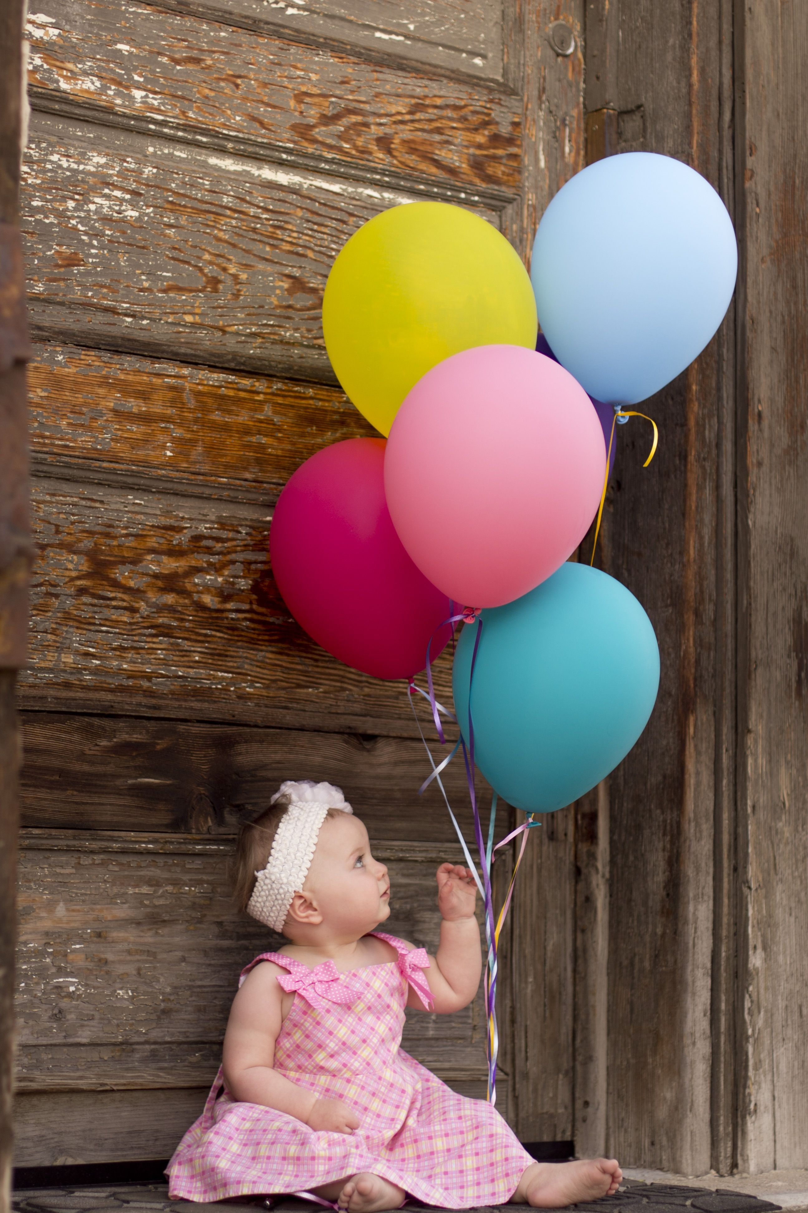 Baby with balloons. Happy spring time.