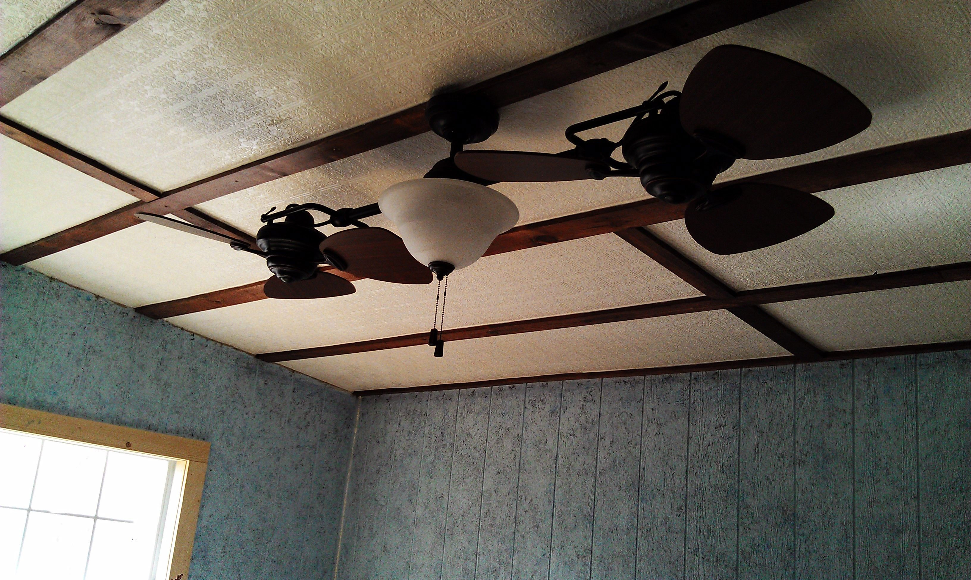 Our bedroom ceiling is embossed wallpaper which has 3 coats of poly our bedroom ceiling is embossed wallpaper which has 3 coats of poly finish and trimed out in wood to look like old ceiling tile dailygadgetfo Choice Image