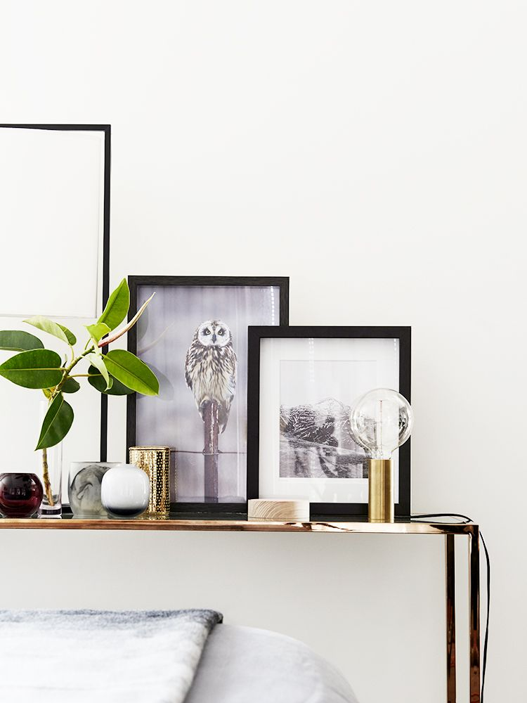 Leaning artwork on mantle with small light