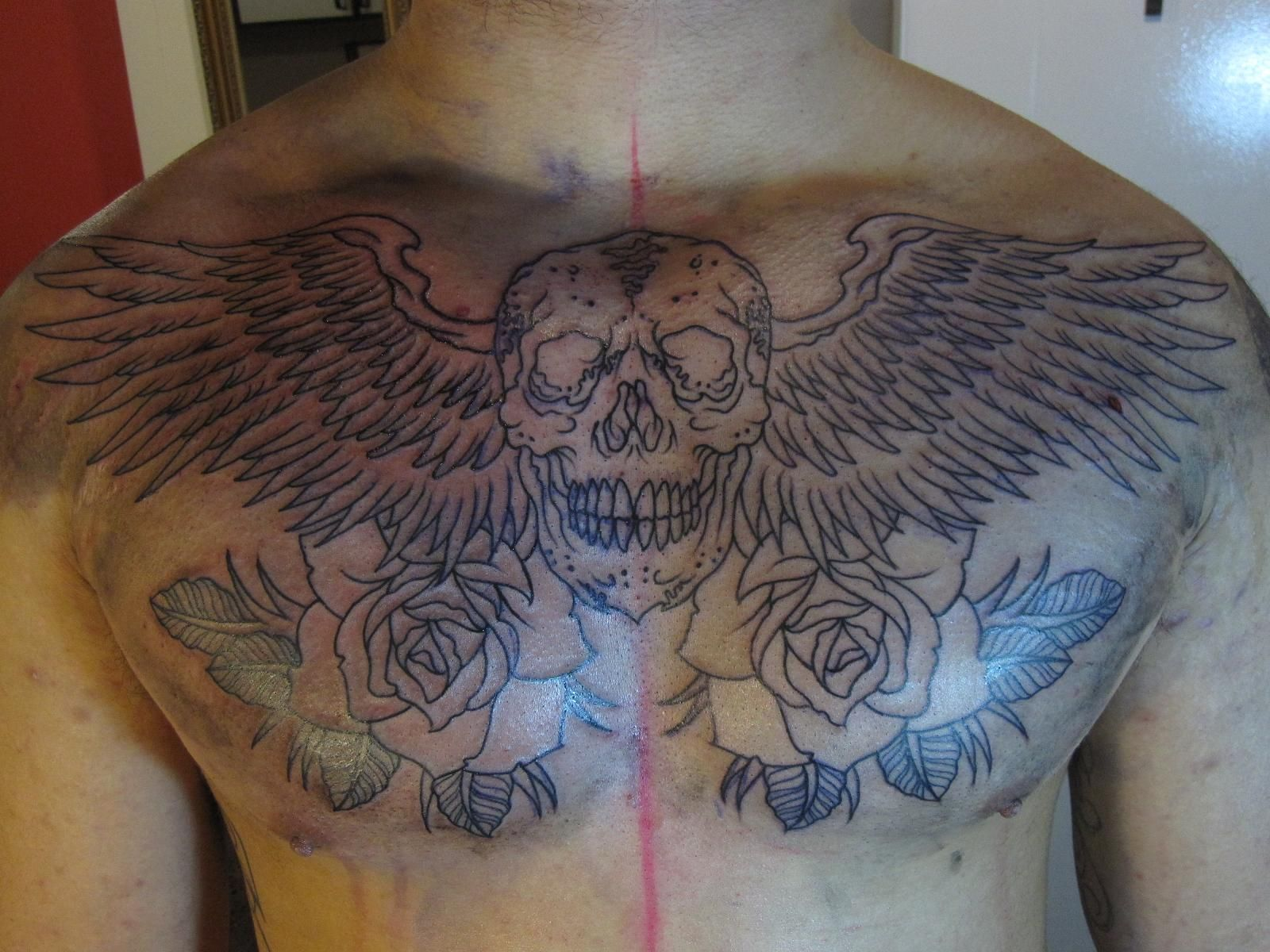 Angel Wings On Chest Tattoos