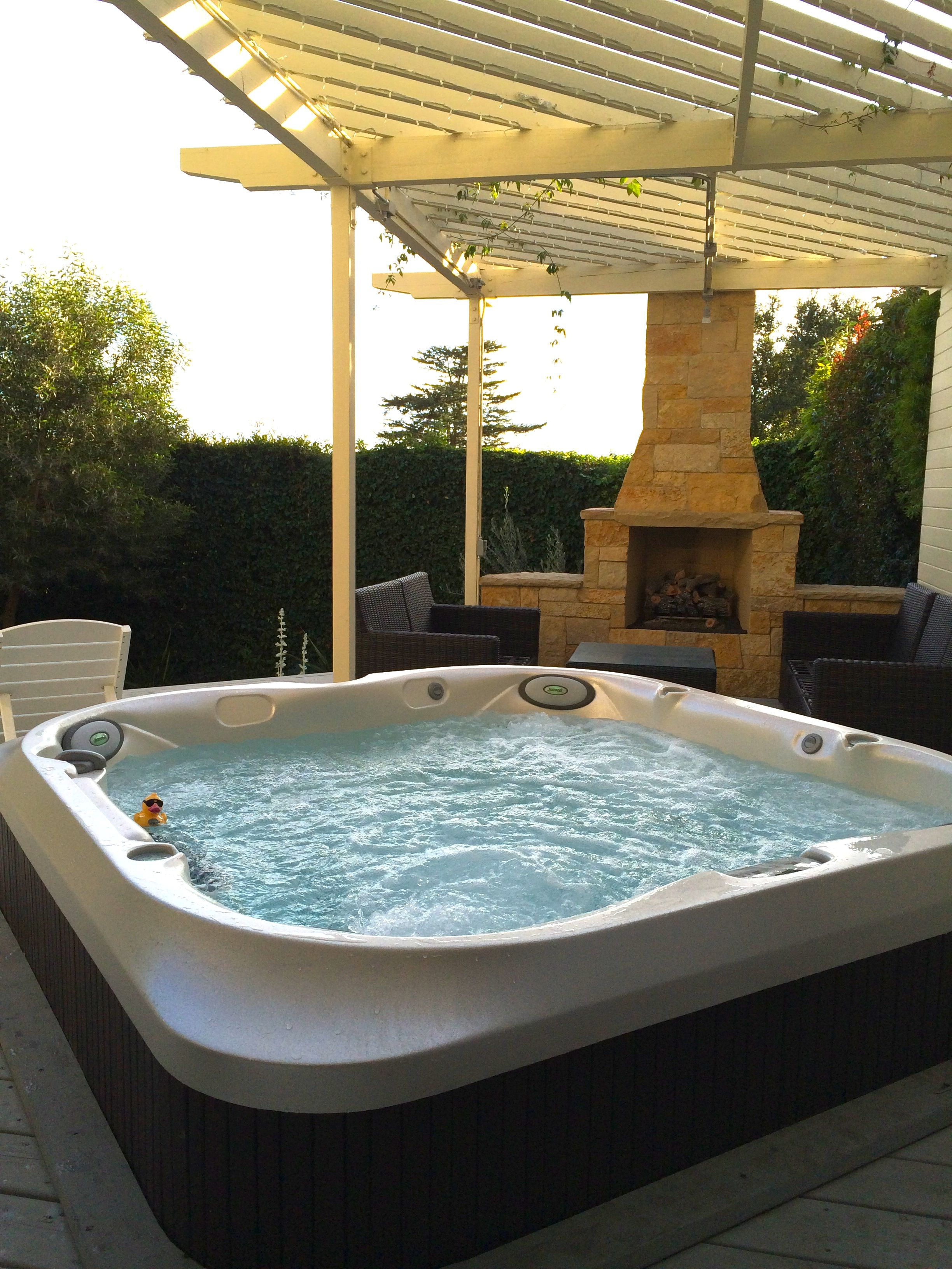 New Jacuzzi J400 Series Spa With Fireplace In The Background