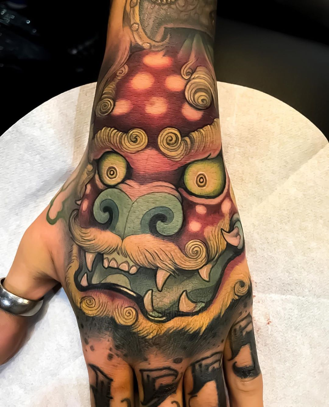 Japanese Ink On Instagram Japanese Inspired New School Foo Dog Hand Tattoos By Victor Chil Swipe Left To Hand Tattoos Foo Dog Tattoo Tattoo Japanese Style