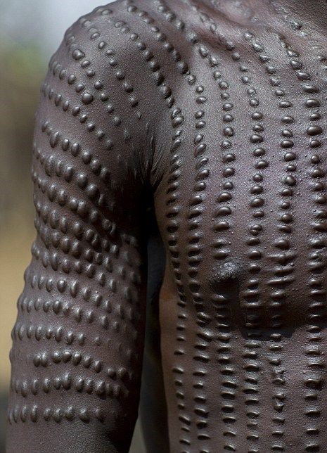 The markings adopted by the Toposa tribe of South Sudan are among the most intricate and involve serried rows of dotted lines.  Photo credit: Eric Lafforgue