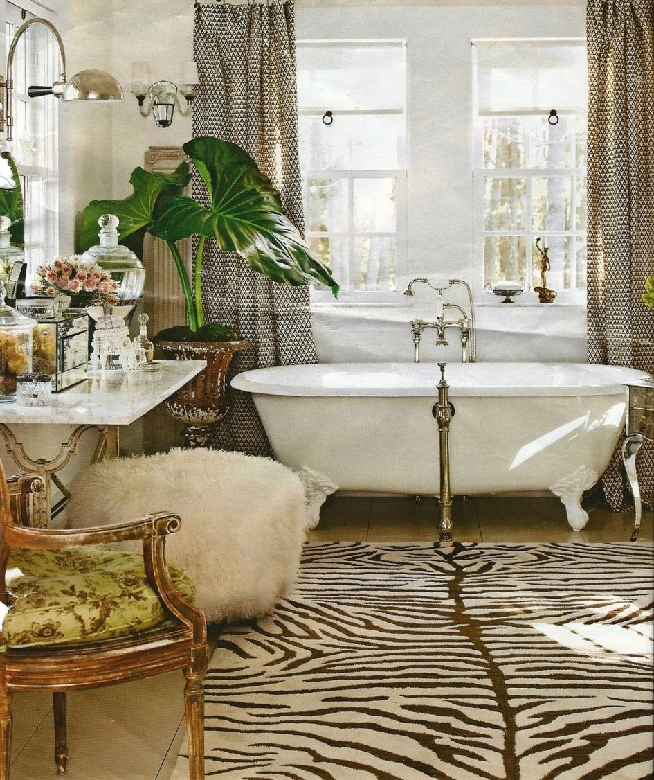 love it that they totally went for it! zebra rug, claw foot tub