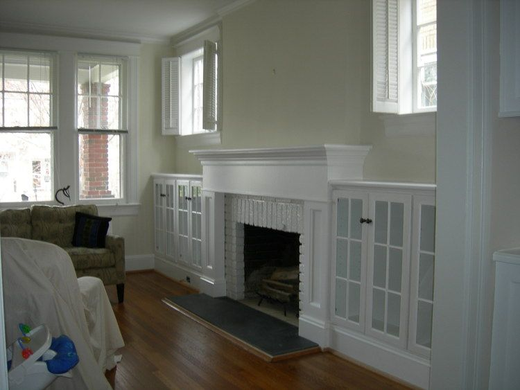Mantel With Cabinets On Either Side Gl Doors