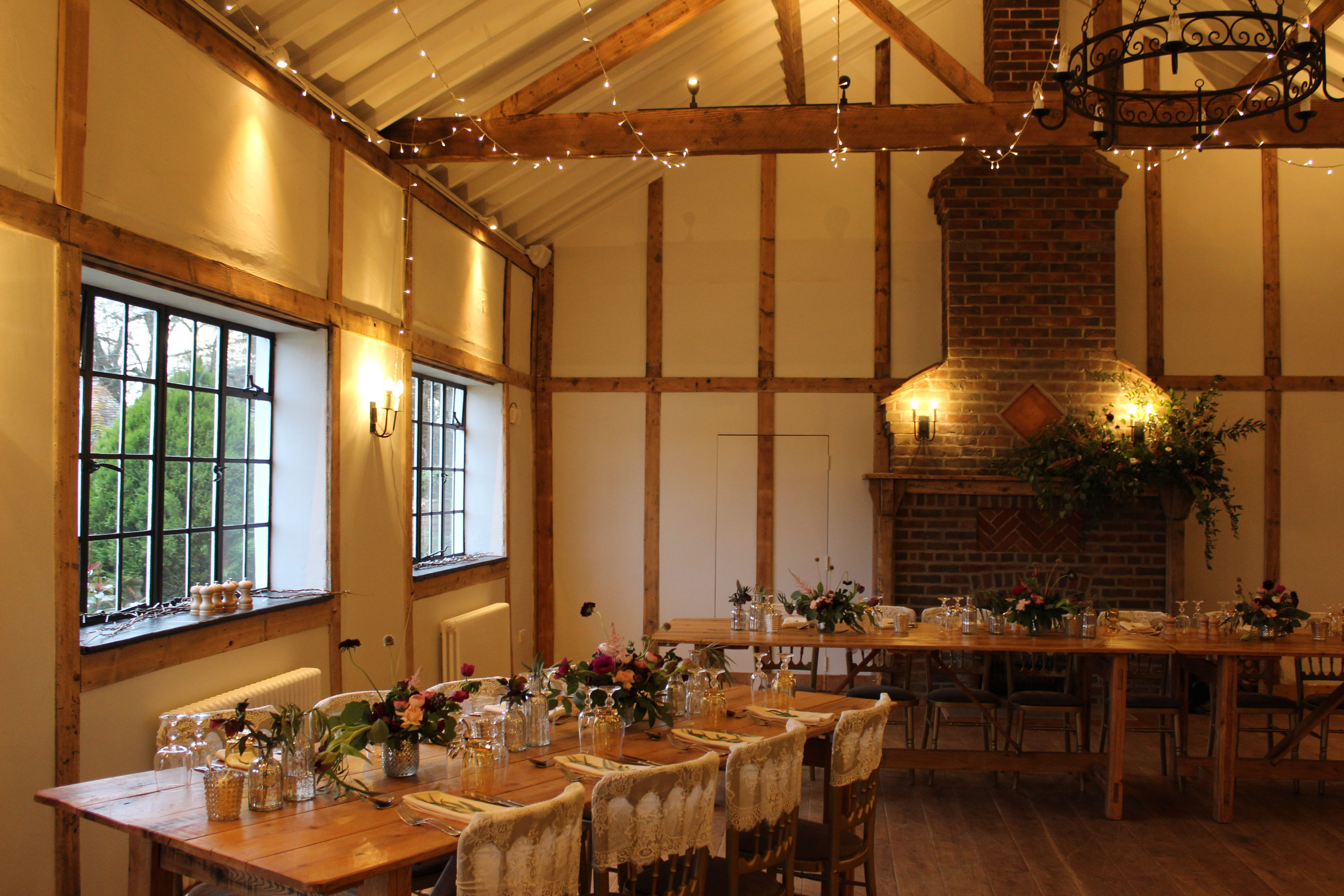 Barn wedding with fairy lights  Roaring fires and fairy lights draped across the ceiling make for