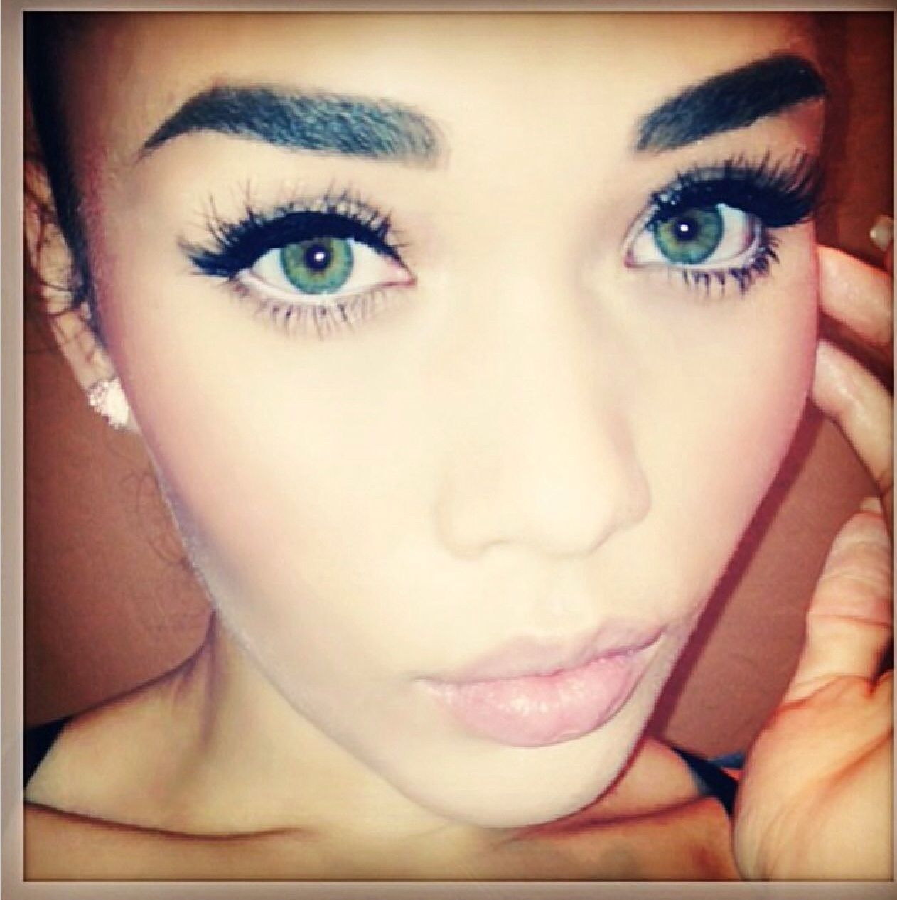 Thick black eyeliner upper lid, white eyeliner on waterline ...