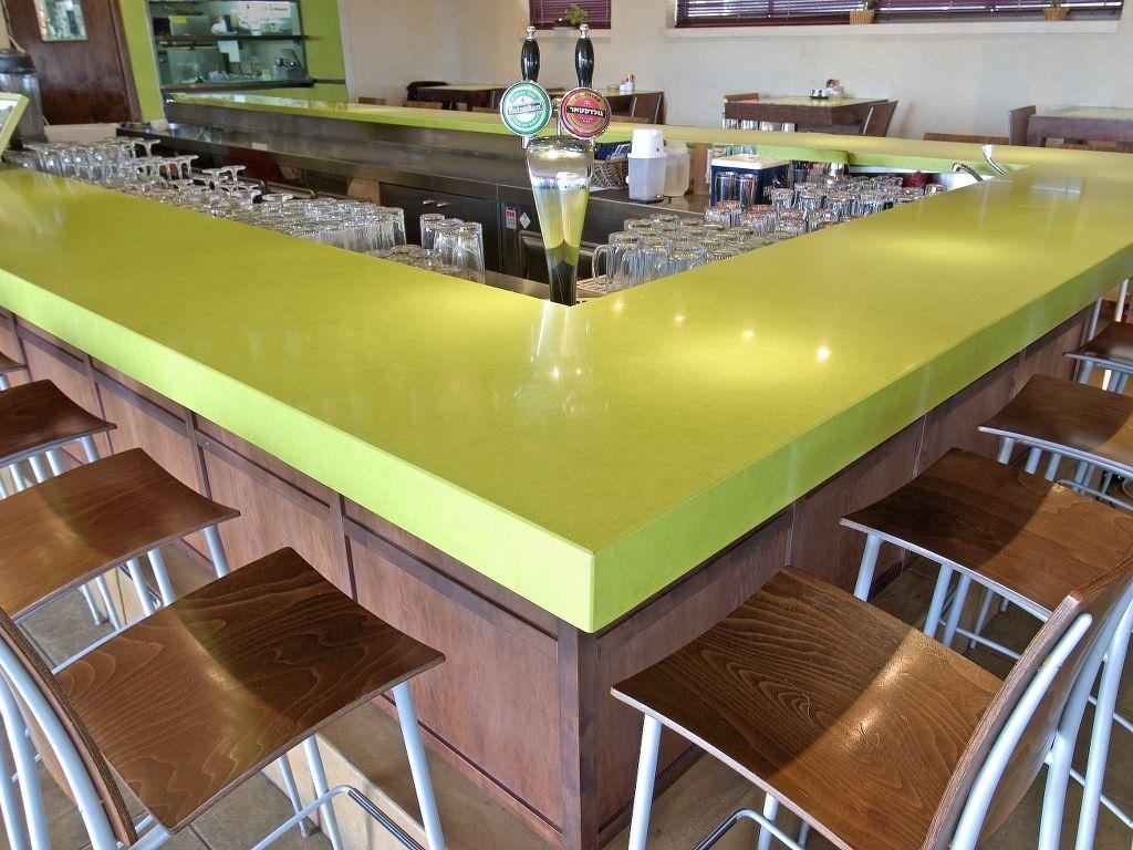 Chroma Quartz Green Countertops With Copper Barstools