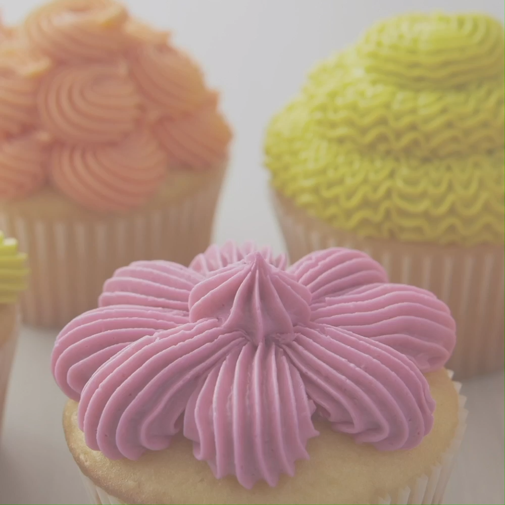Learn how to make fun cupcake decorations using star tip 32. From shells to rosettes, these cupcakes are a great way to show off your decorating skills. Bright icing colors make these cupcakes great for summer entertaining, and you'll love showing off all your new techniques with this collection of colorful cupcakes. #wiltoncakes #bakehappyinsnap #cupcakedecorating #cupcakeideas #buttercreamfrosting #homemade #baking #tip32 #basic #simple #beginner #easy #wiltontips #pipingtips