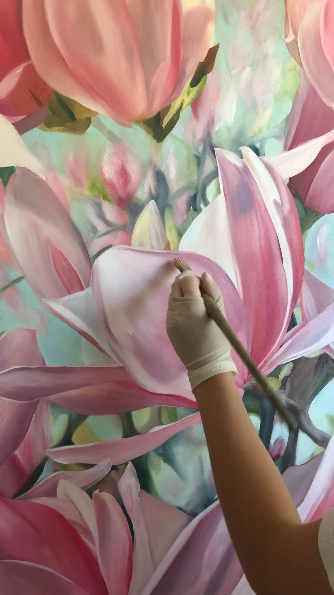 Time lapse of artist, CoCo Zentner, painting realistic pink Japanese Magnolia flowers for living room in New Orleans