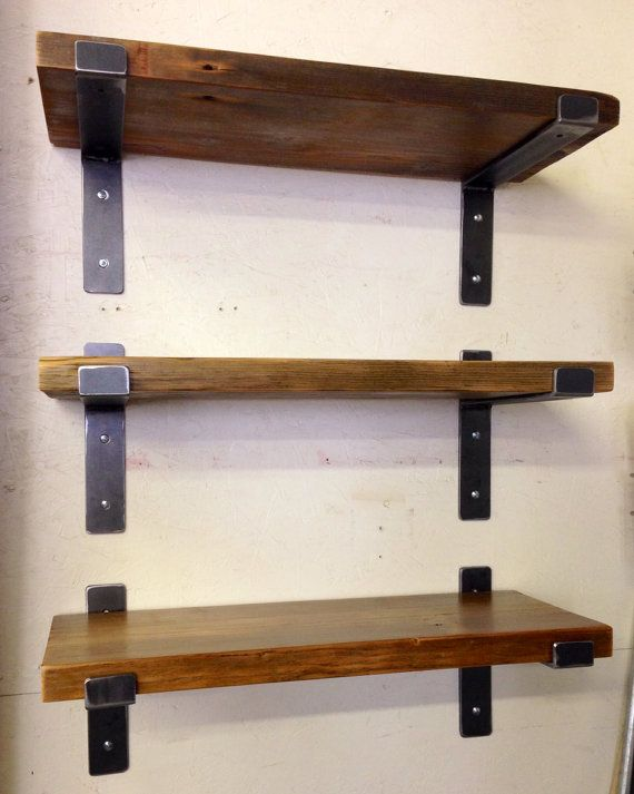 Hand Welded From Steel, These Perfectly Designed Metal Brackets By Mc Lemay  For Lemay+rivenbark Design Lab Features Reclaimed Wood Shelves.