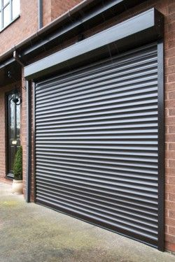 A Black Shutter Garagedoor Common But Stylish Roller Doors Garage Door Design Garage Door Styles