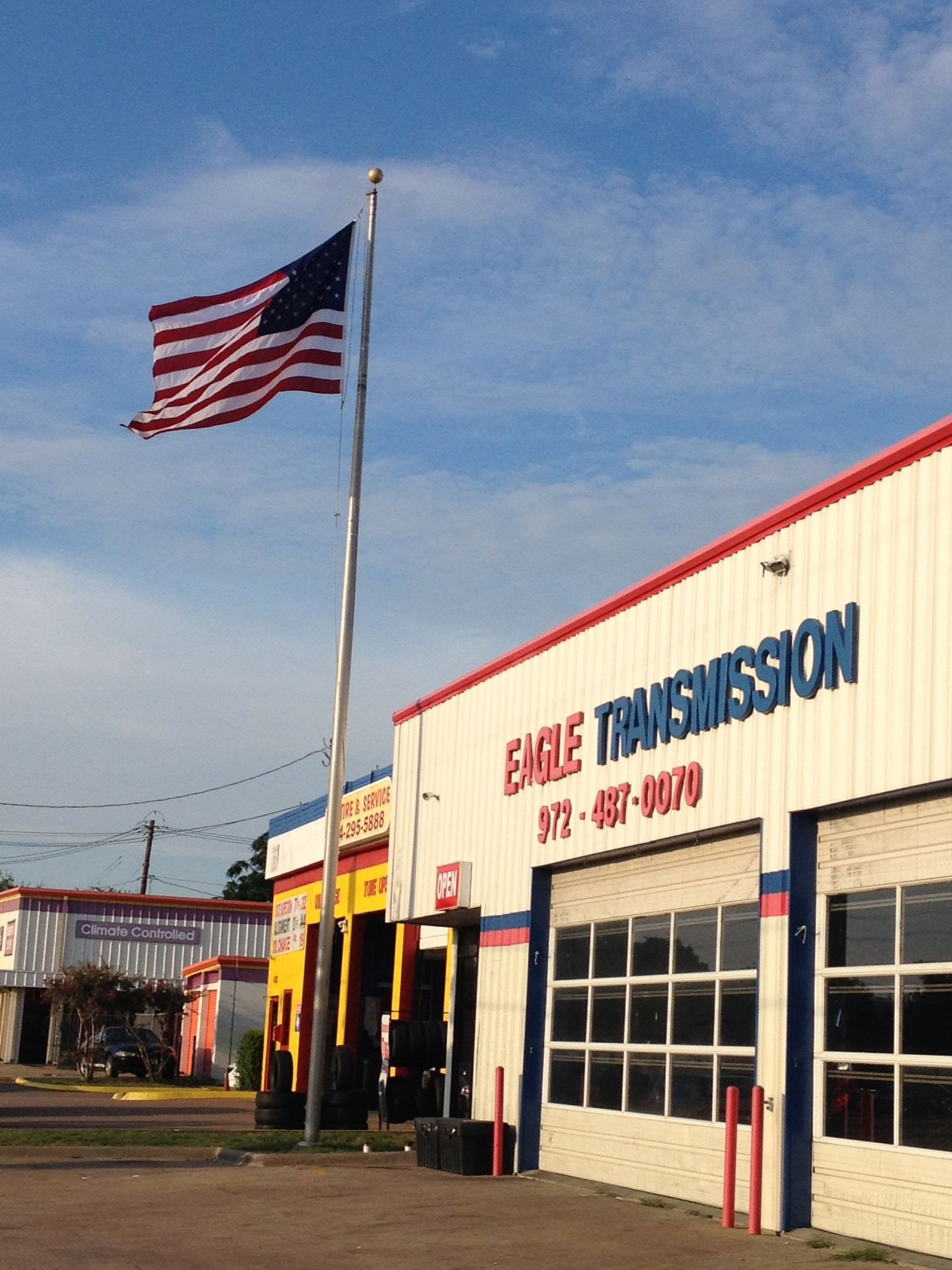 American flag flying high at the shop American flag, Repair