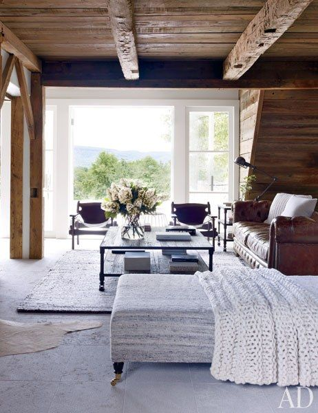 French doors open from the living room to the terrace. The Sergio Rodrigues leather armchairs are from Espasso | archdigest.com